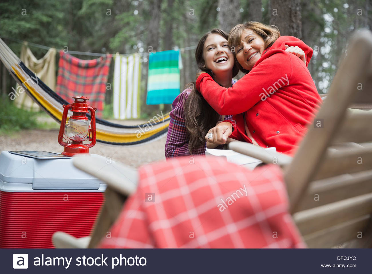 Affectionate grandmother and granddaughter at campsite - Stock Image