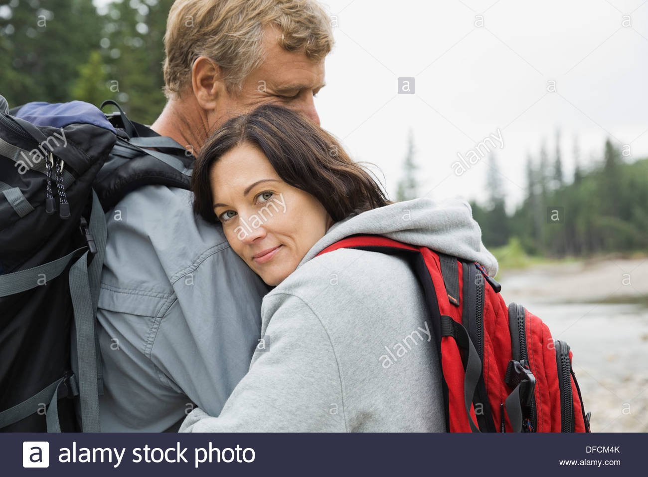 Portrait of affectionate couple outdoors - Stock Image