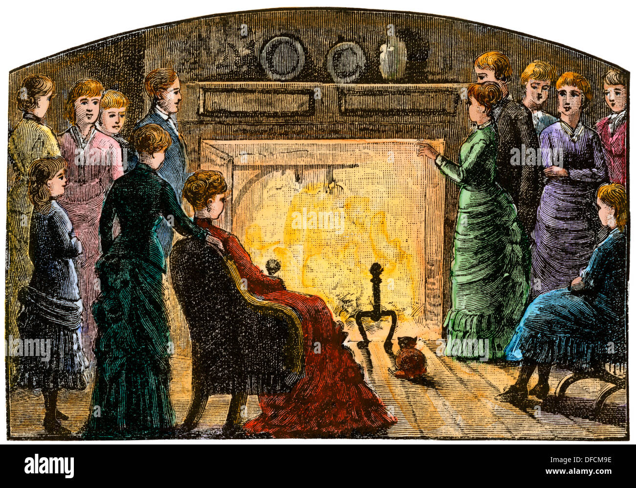People gathered around the Wayside Inn hearth, Concord, MA, 1800s. Hand-colored woodcut - Stock Image