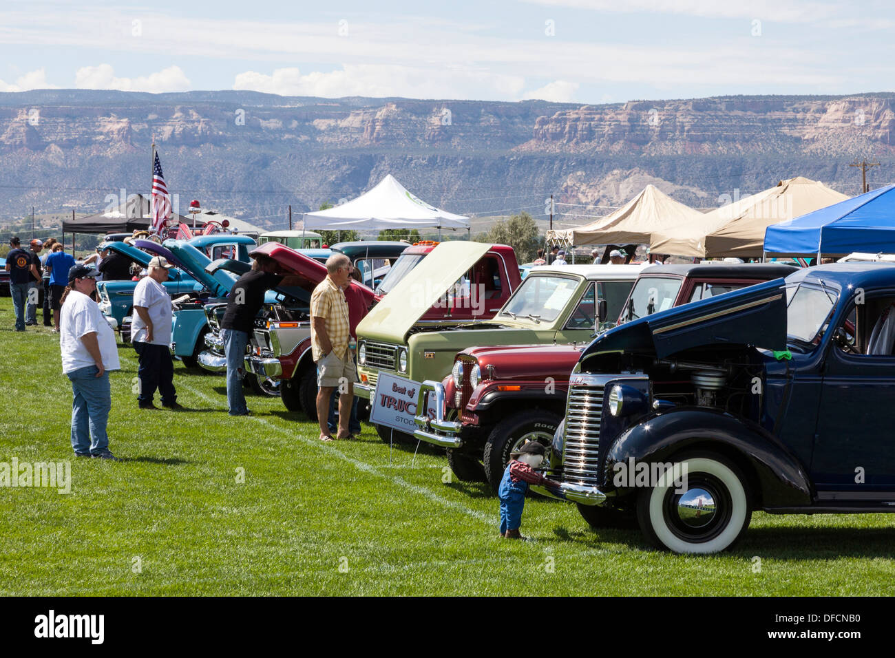 Spectators at a Classic Car show near Grand Junction, Colorado looking at a customised and collectable automobiles. USA - Stock Image