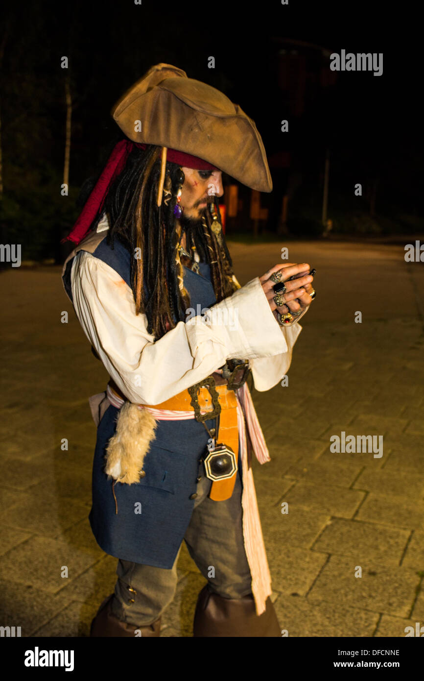Geordie Depp seen checking his smartphone whilst supporting a Ty Hafan midnight walk - Stock Image