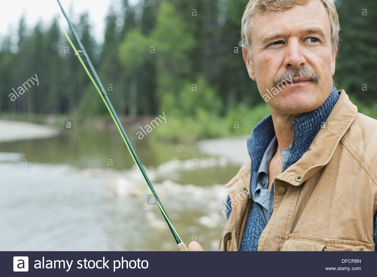 Portrait of mature man fishing - Stock Image