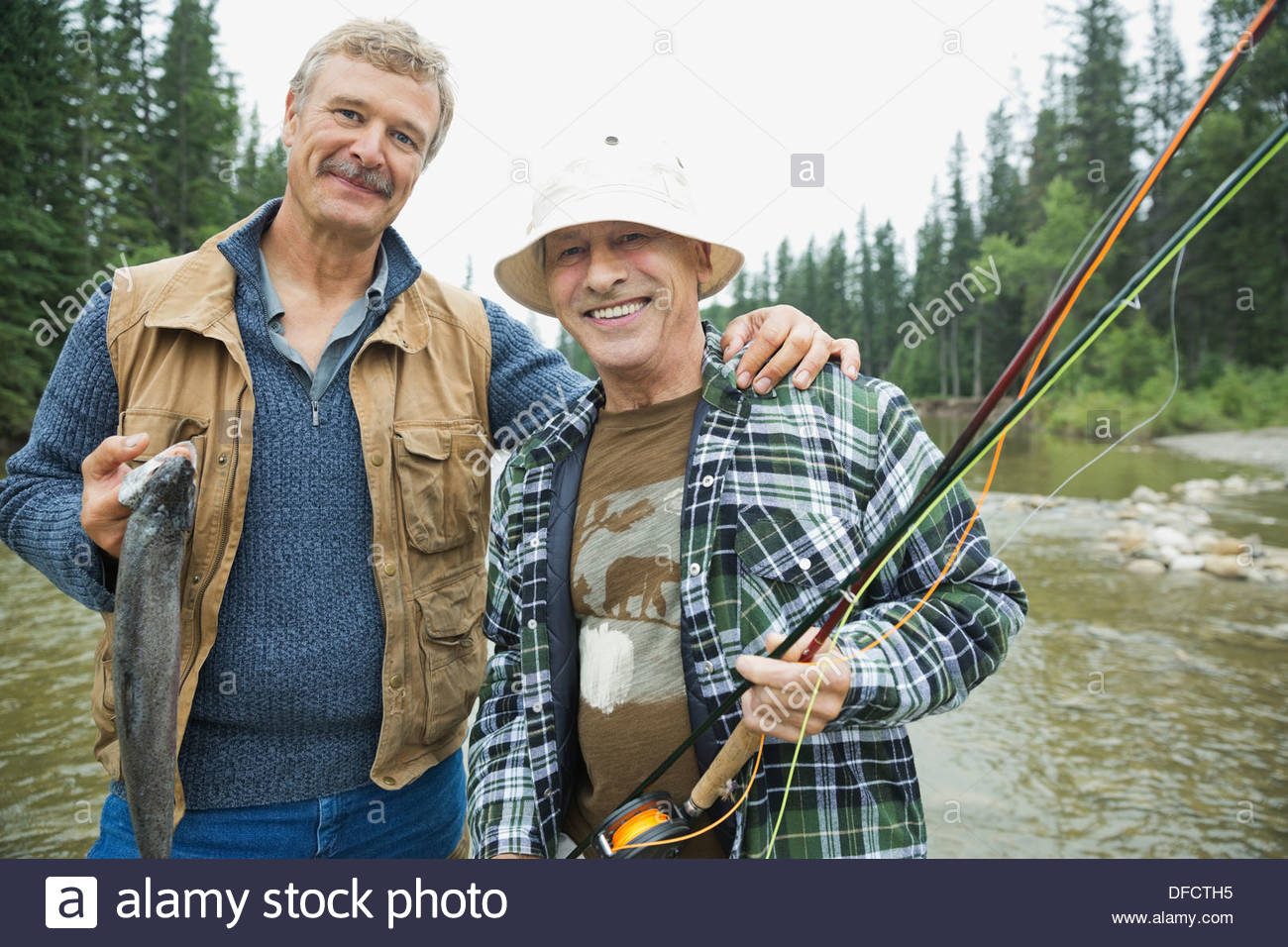 Portrait of men fishing together - Stock Image