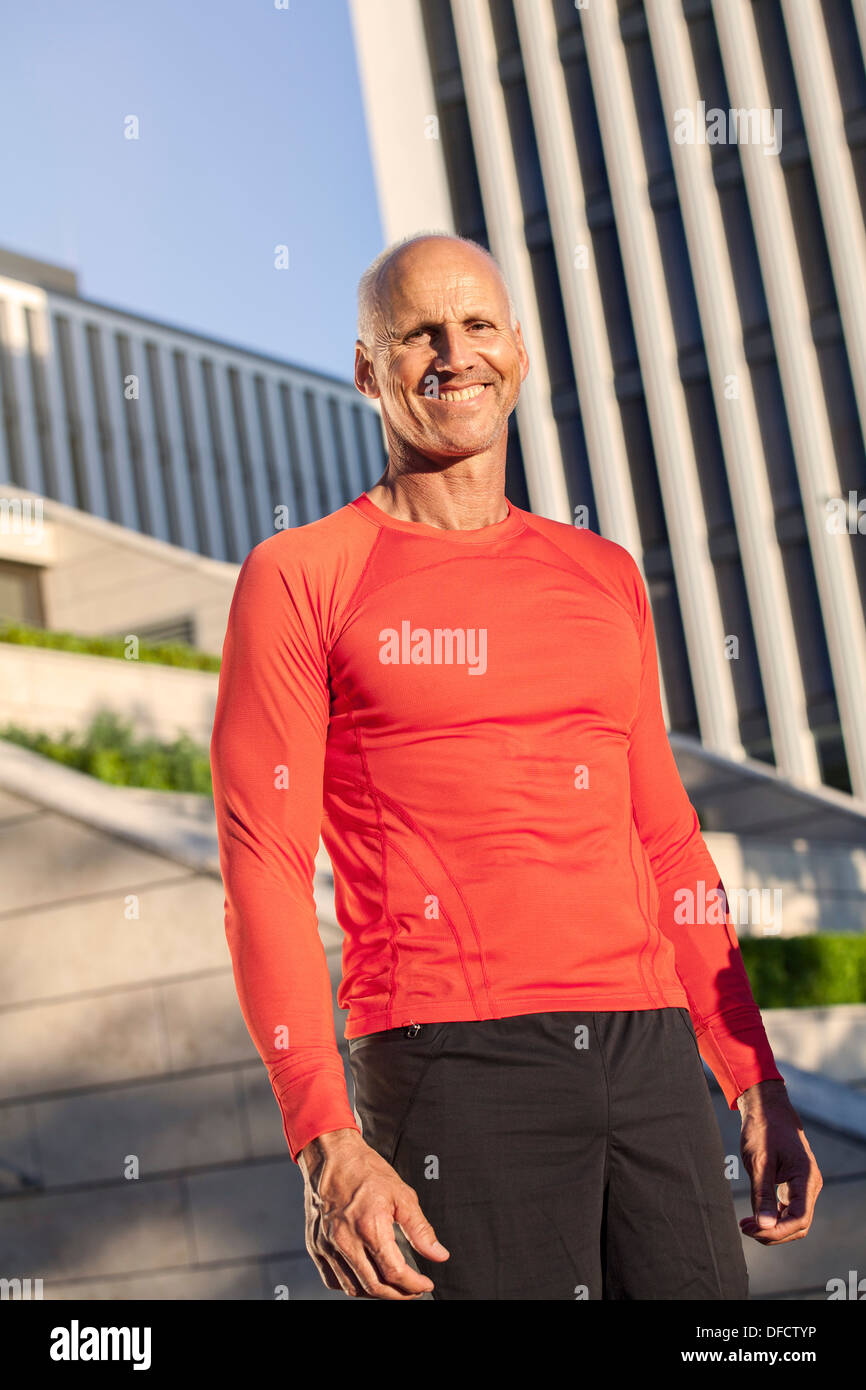 Smiling mature athletic man outdoors - Stock Image