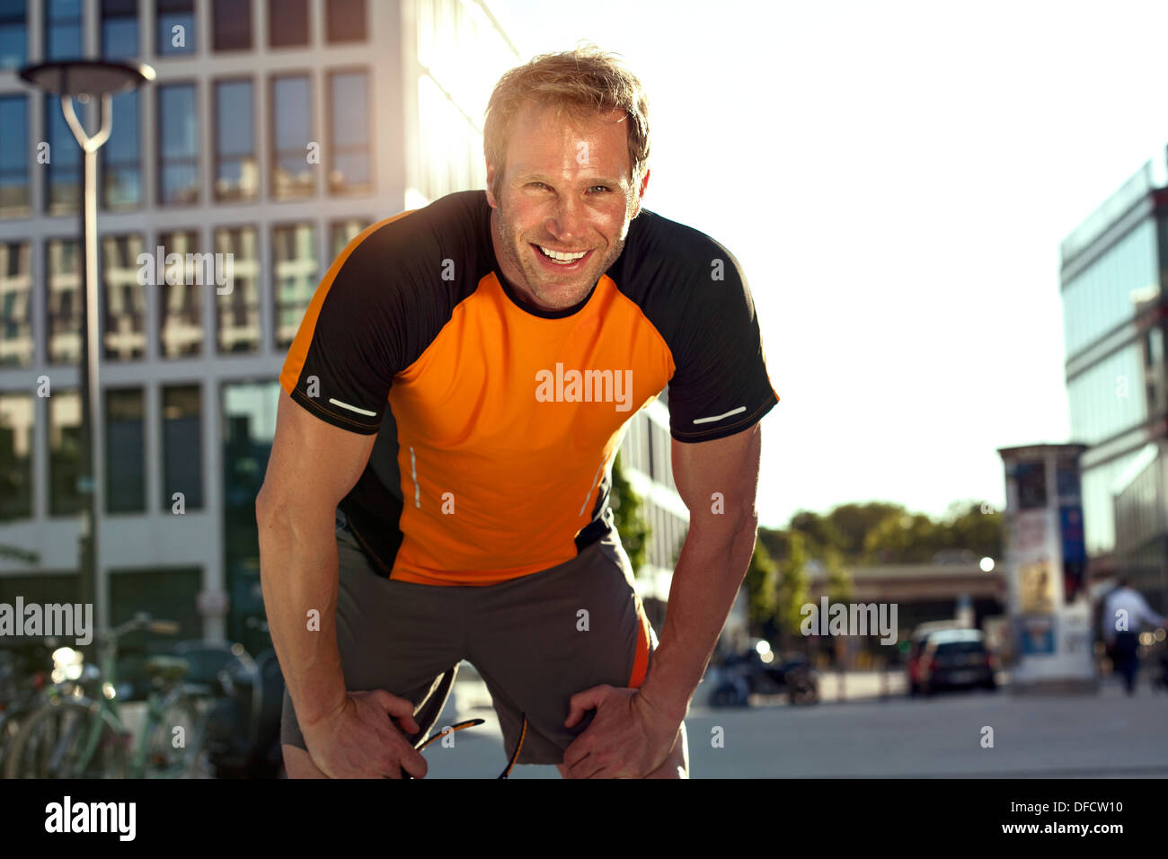 Smiling athletic man outdoors - Stock Image