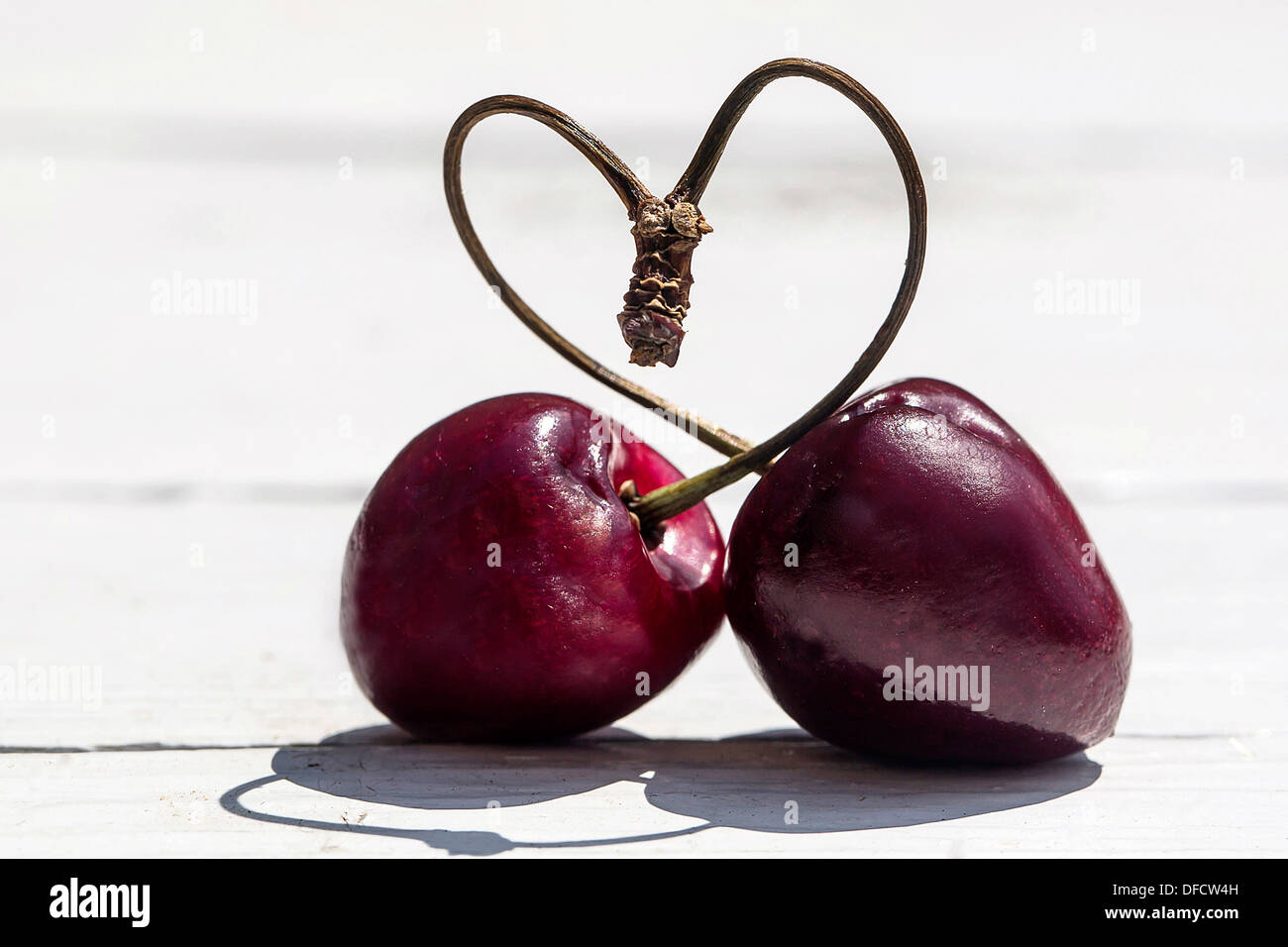 Germany, Bavaria, Heart shaped formed with stems of cherry - Stock Image