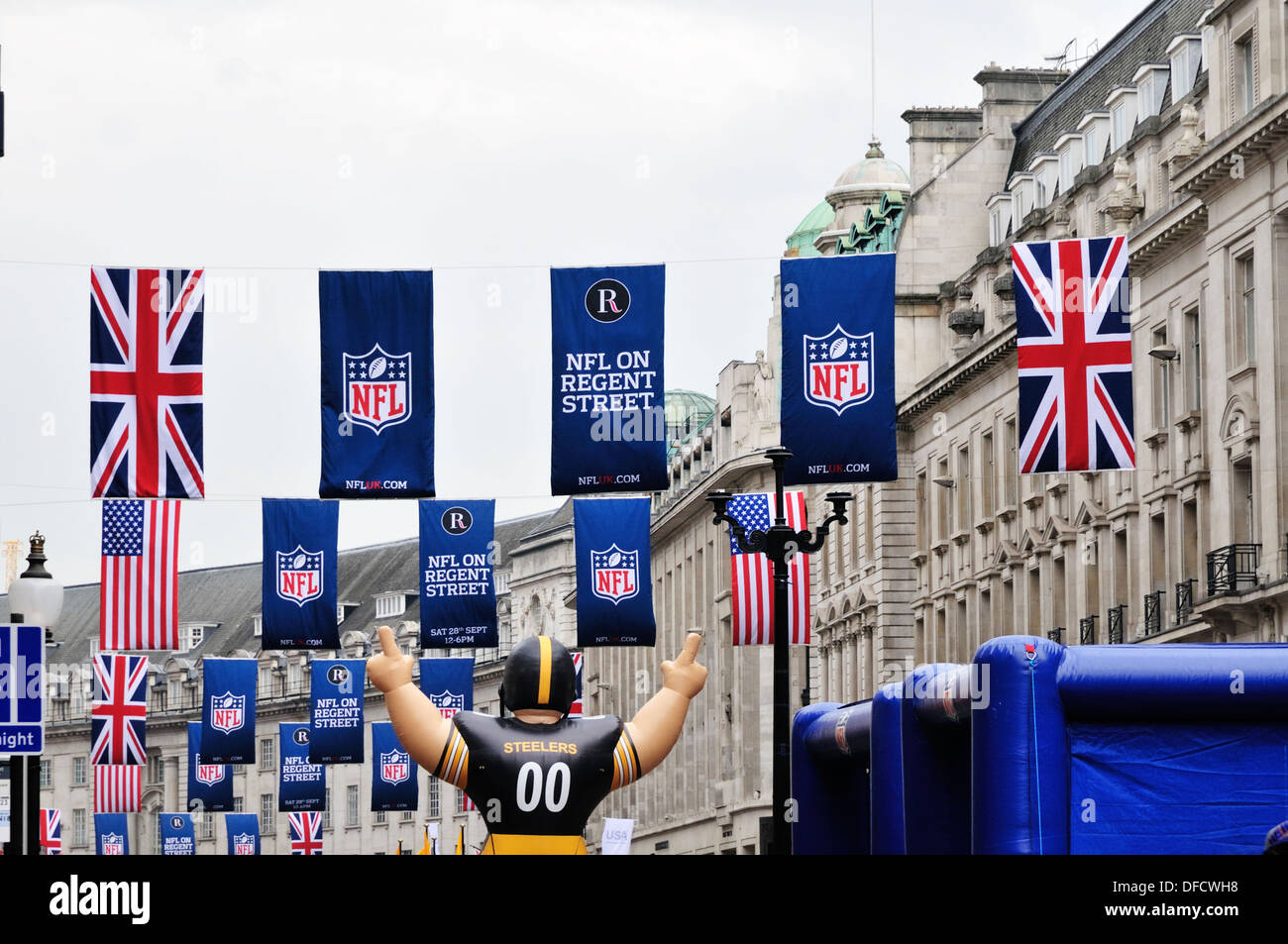 Flags and banners hanging above Regent Street during the NFL block party on 28th September 2013 - Stock Image