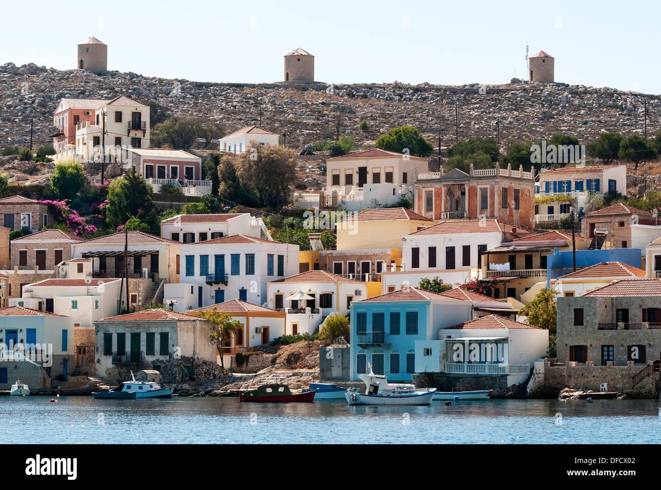 Three old Windmills at Emborio Harbour, Halki, Greece. - Stock Image