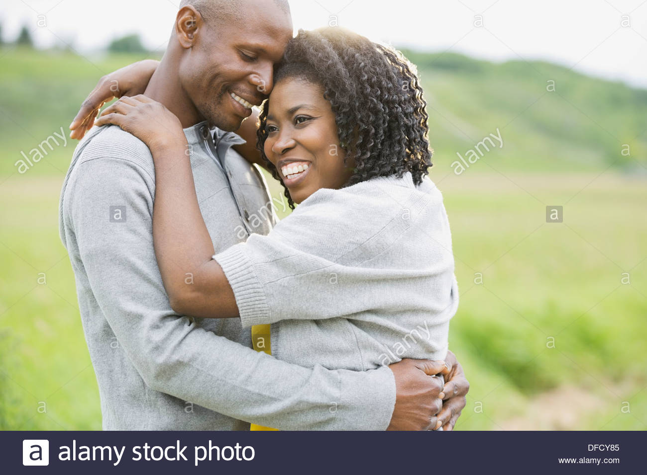 Affectionate couple embracing outdoors - Stock Image