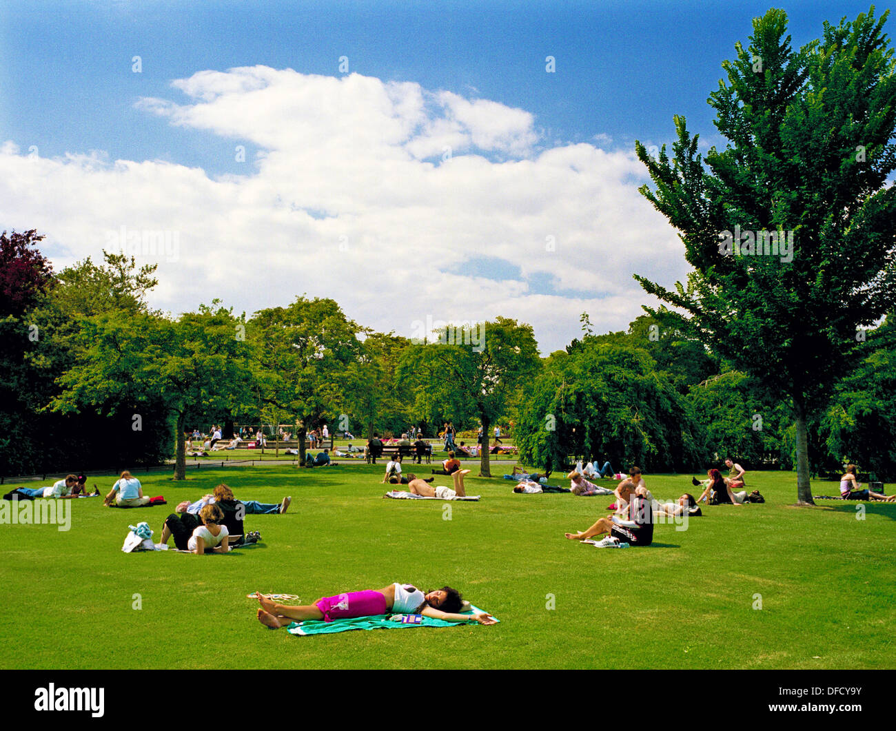 On a hot summer day Saint Stephen's Green in the center of Dublin, Ireland is a place to relax and cool off - Dublin, Ireland - Stock Image