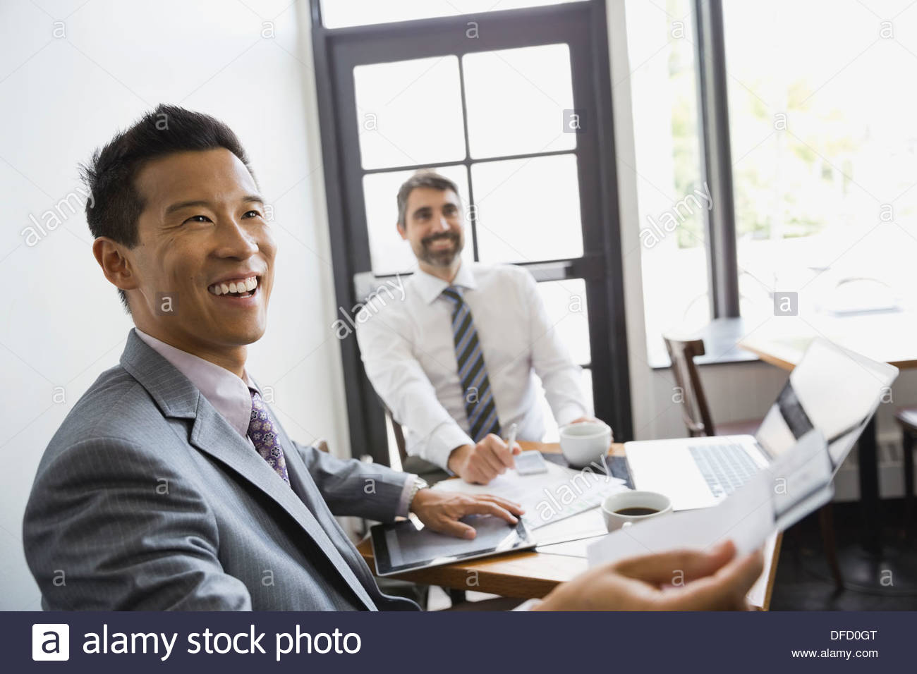 Businessman paying restaurant bill with credit card - Stock Image
