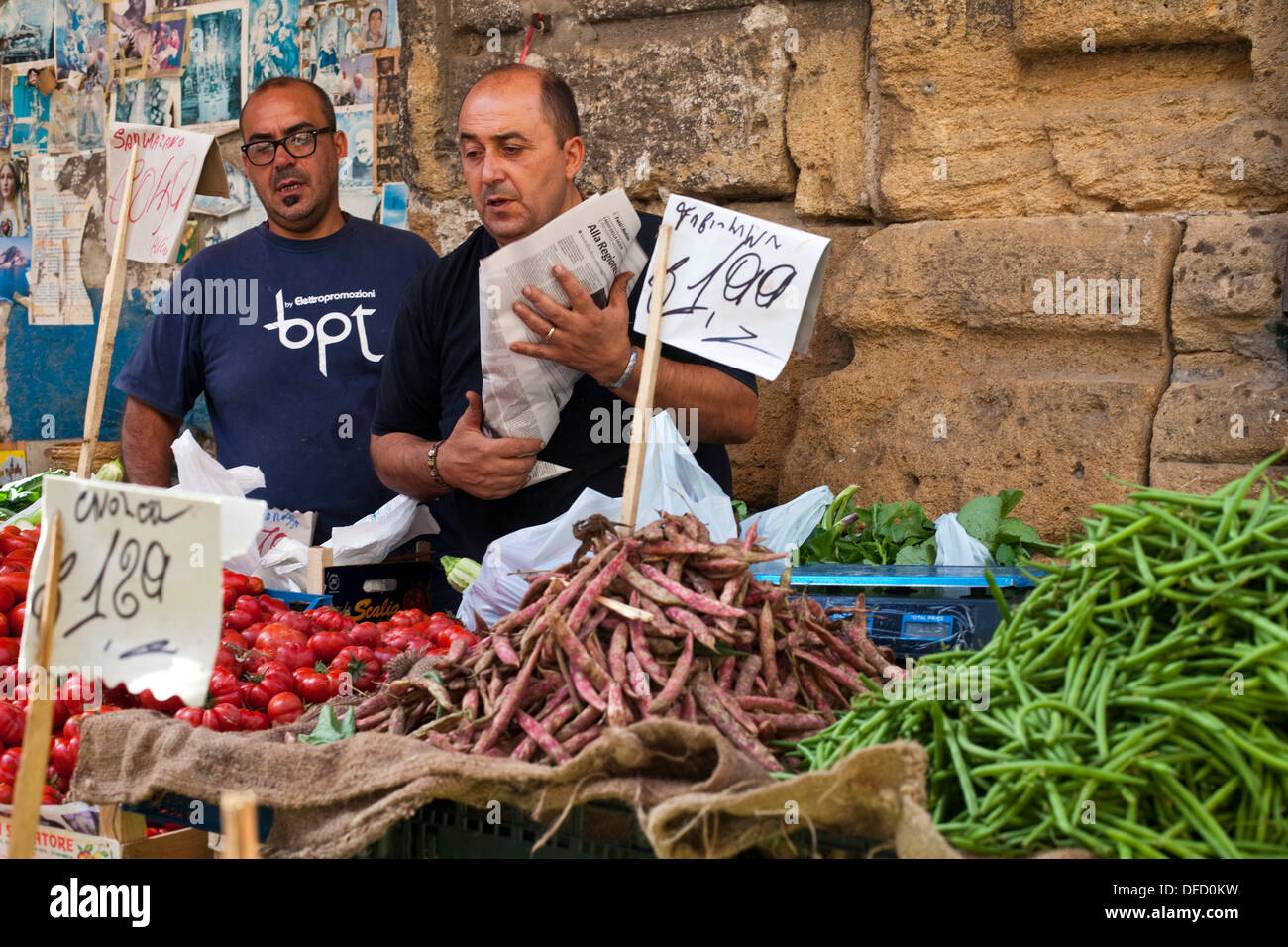 Market traders on their stall in the Capo Market, Palermo, Italy - Stock Image