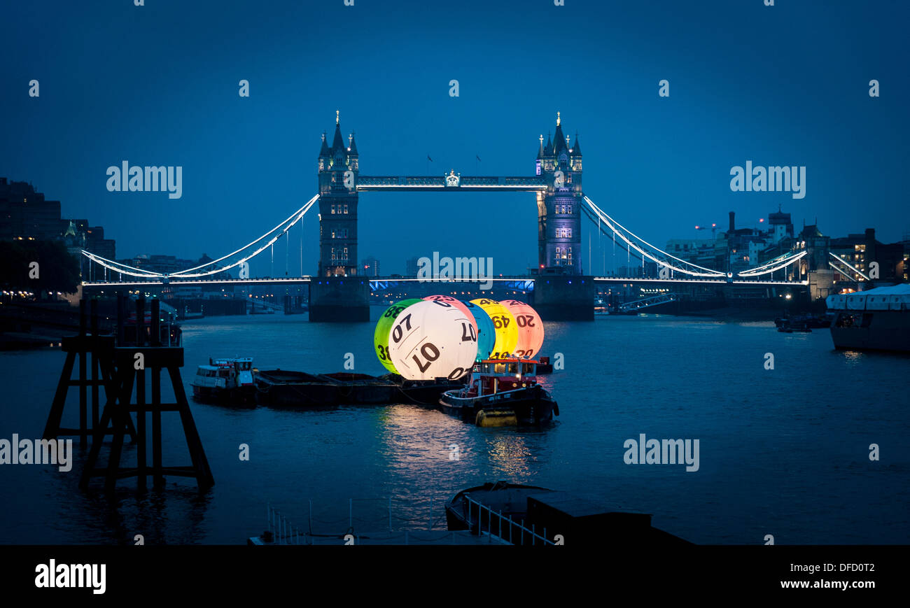 UK National Lottery Balls on the River Thames in front of Tower Bridge, London. - Stock Image