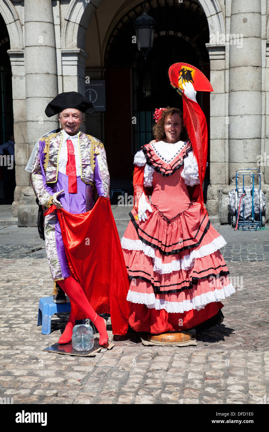 Tourist posing as a matador and flamenco dancer in the Plaza Mayor, Madrid. - Stock Image