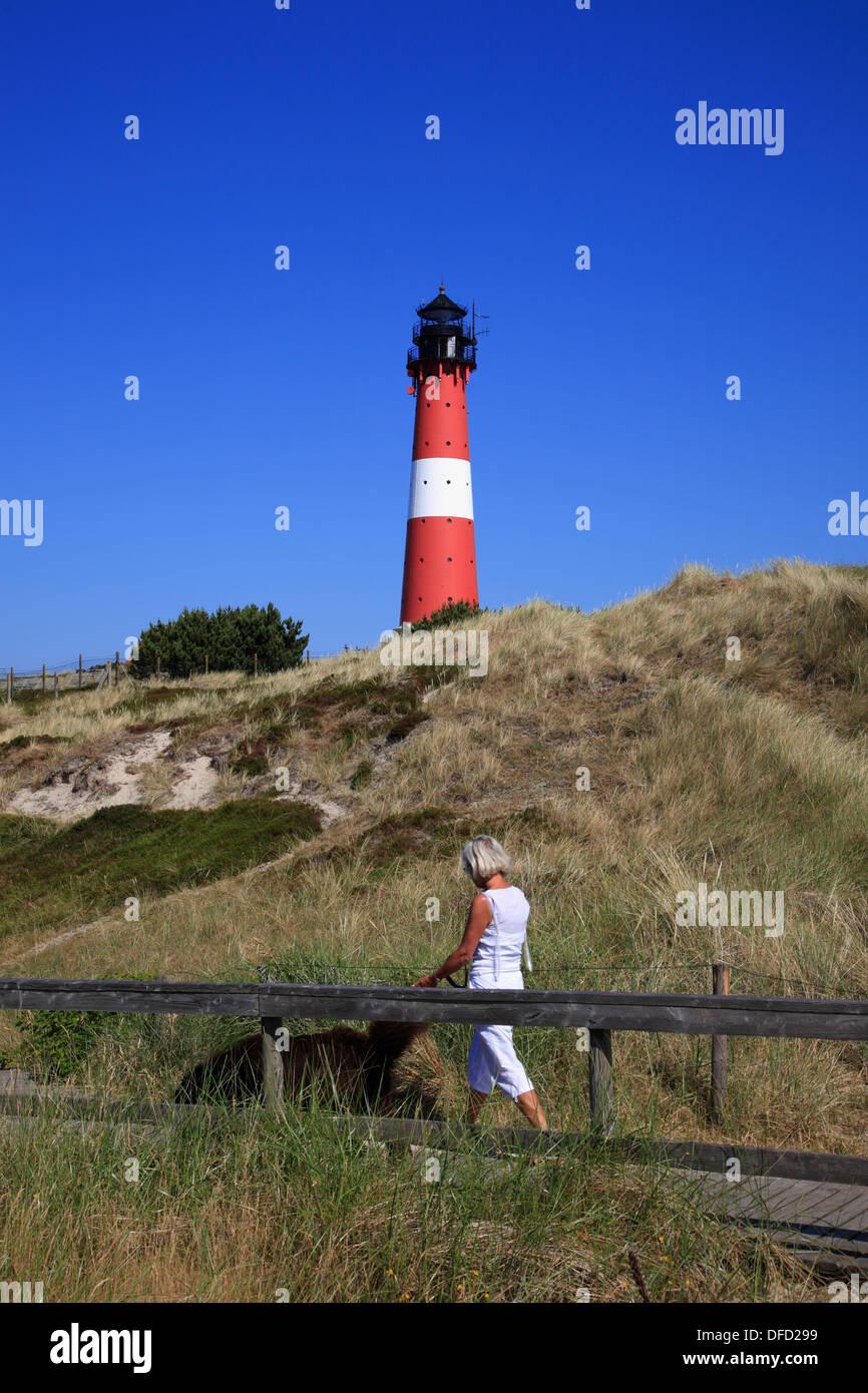 Hiker at Hoernum lighthouse, Sylt Island, Schleswig-Holstein, Germany - Stock Image