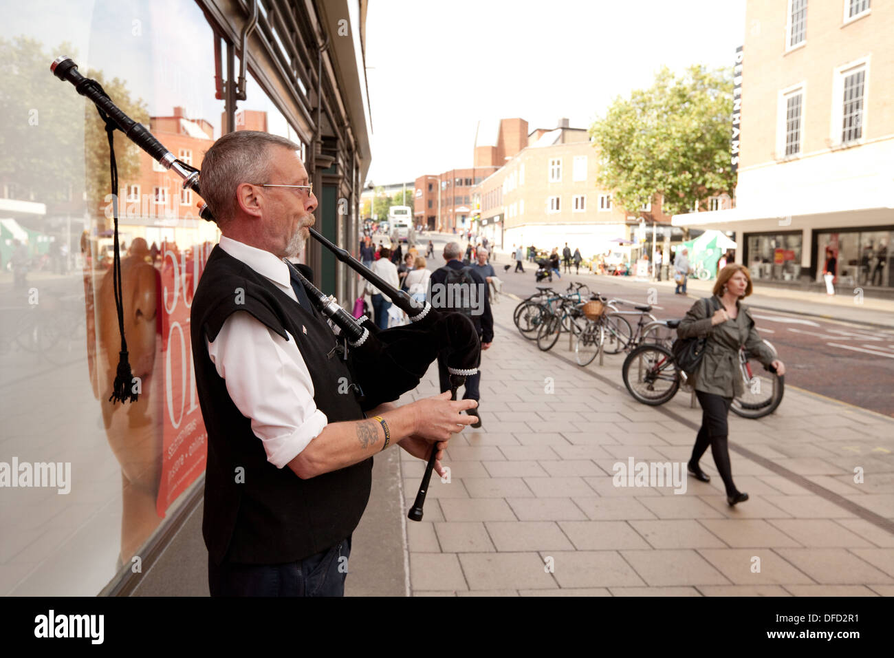 A Busker playing the bagpipes, Norwich, Norfolk UK - Stock Image