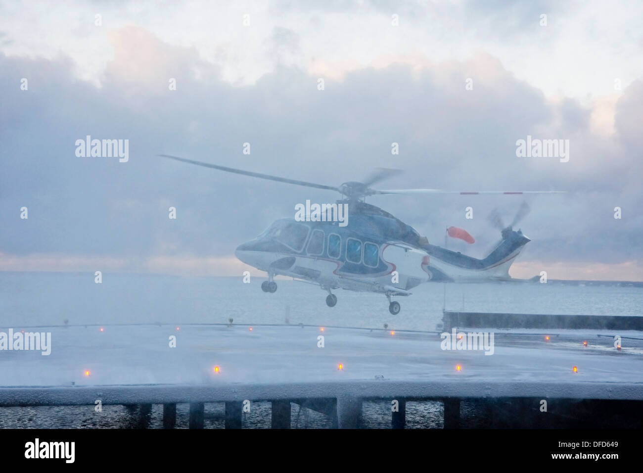 Helicopter in snow storm - Stock Image