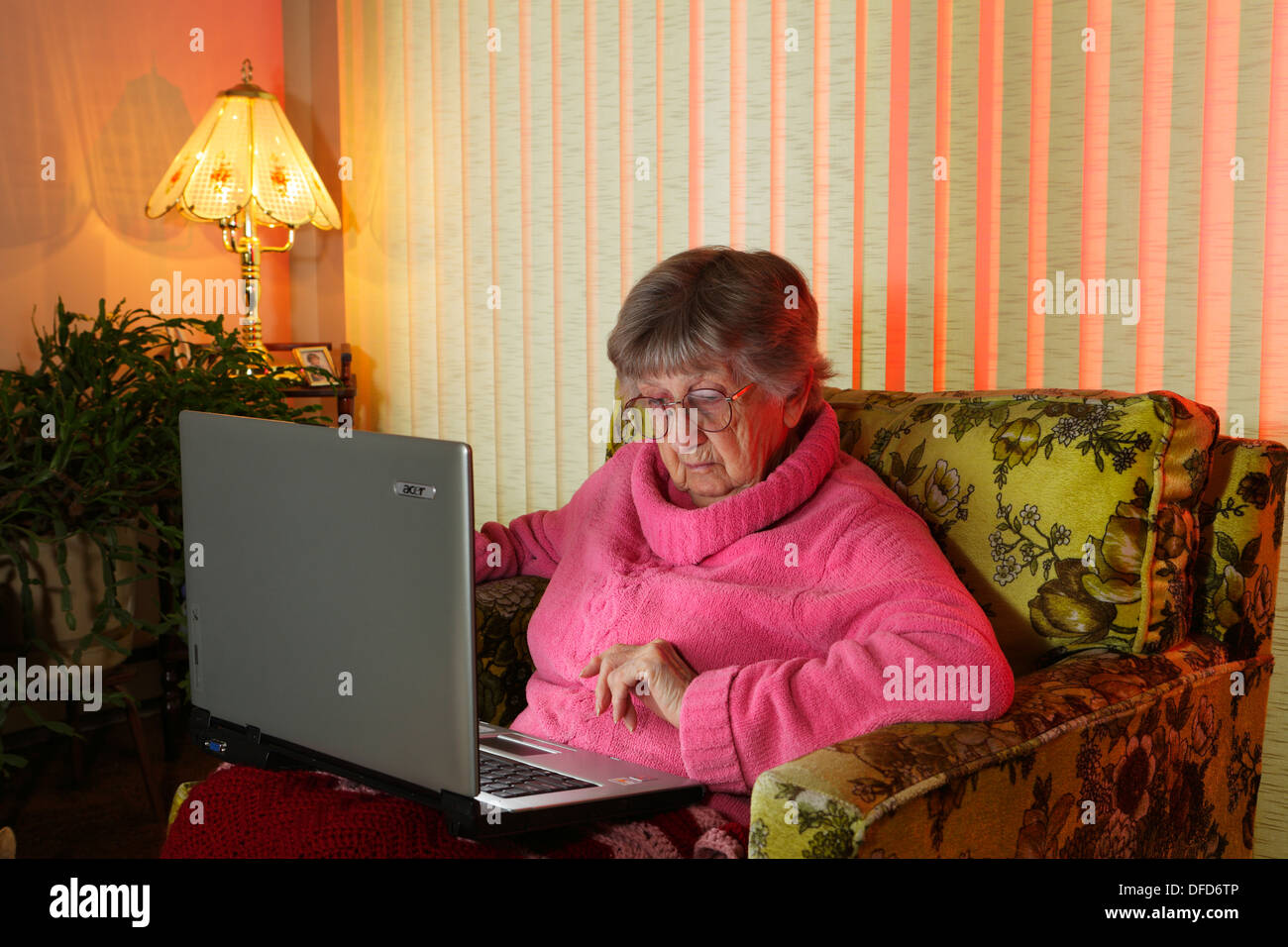 Elderly lady working on laptop computer-Victoria, British Columbia, Canada. - Stock Image