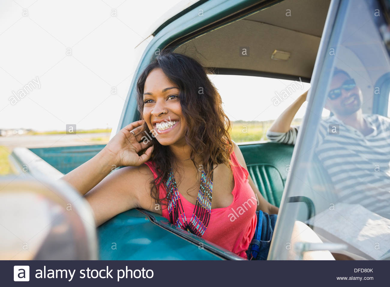 Woman looking out from window of pick-up truck - Stock Image