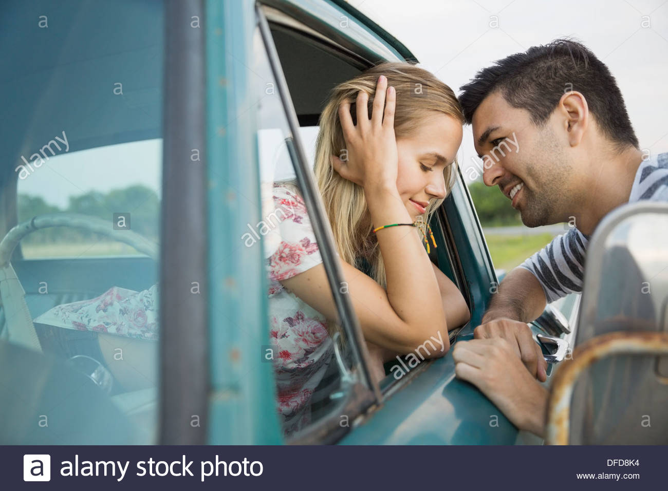Affectionate young couple outdoors - Stock Image