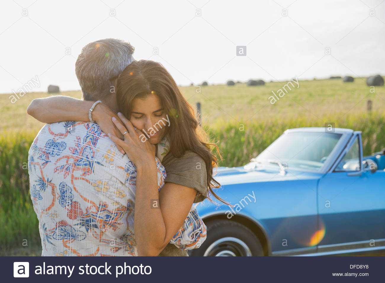 Affectionate couple hugging outdoors - Stock Image
