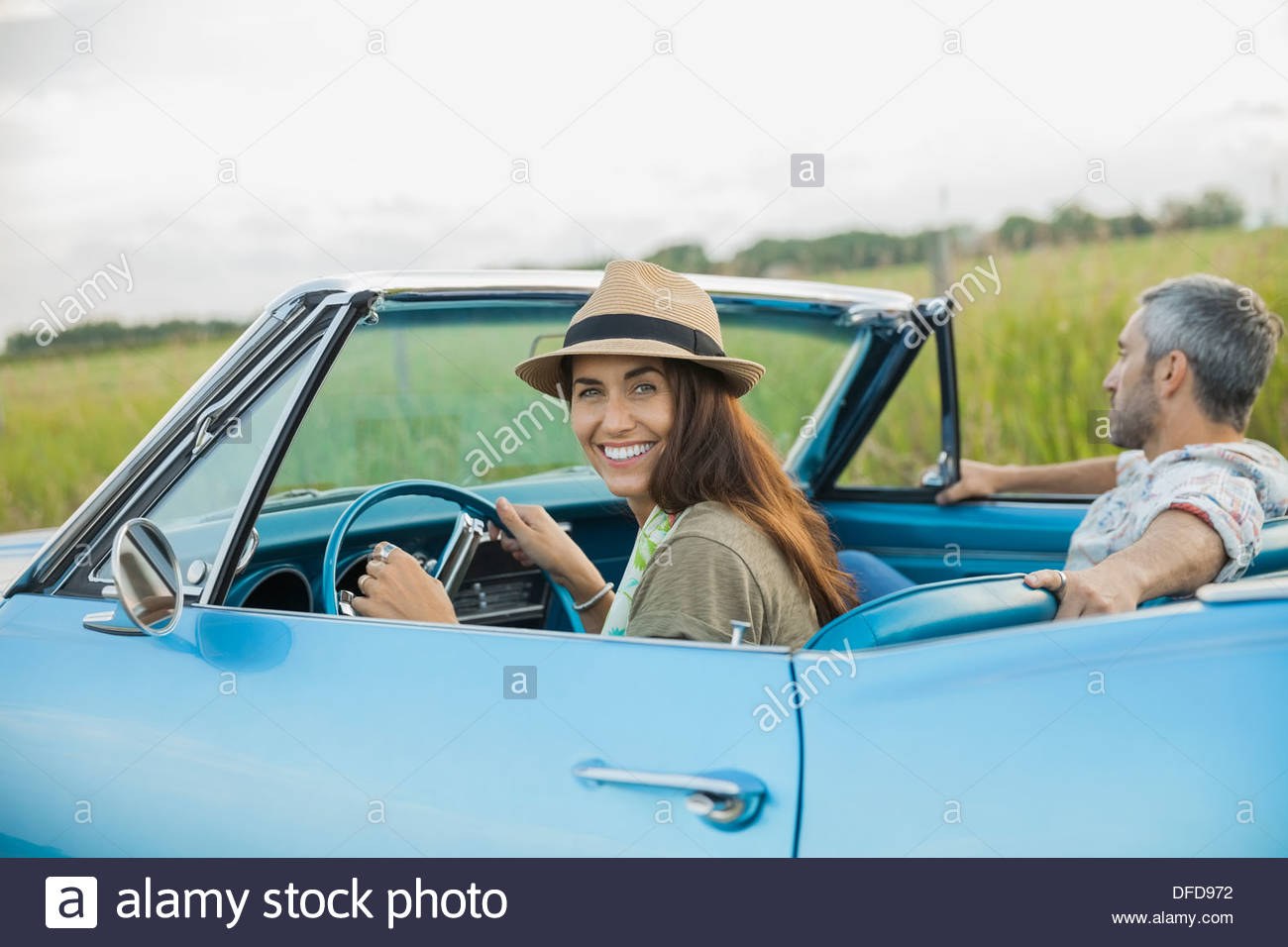 Portrait of couple in blue convertible Stock Photo
