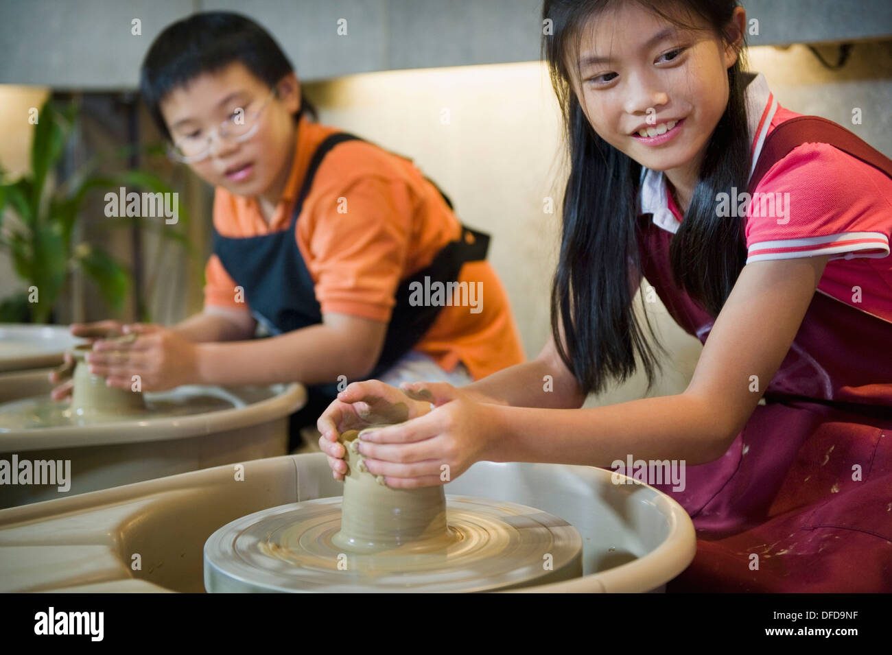 Taiwanese Kids Taking Part In A Pottery Making Class, An Industry That Has  Flourished In The Region.