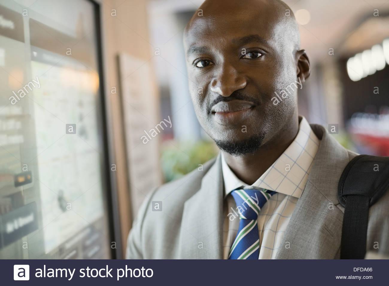 Close-up portrait of confident businessman at airport - Stock Image