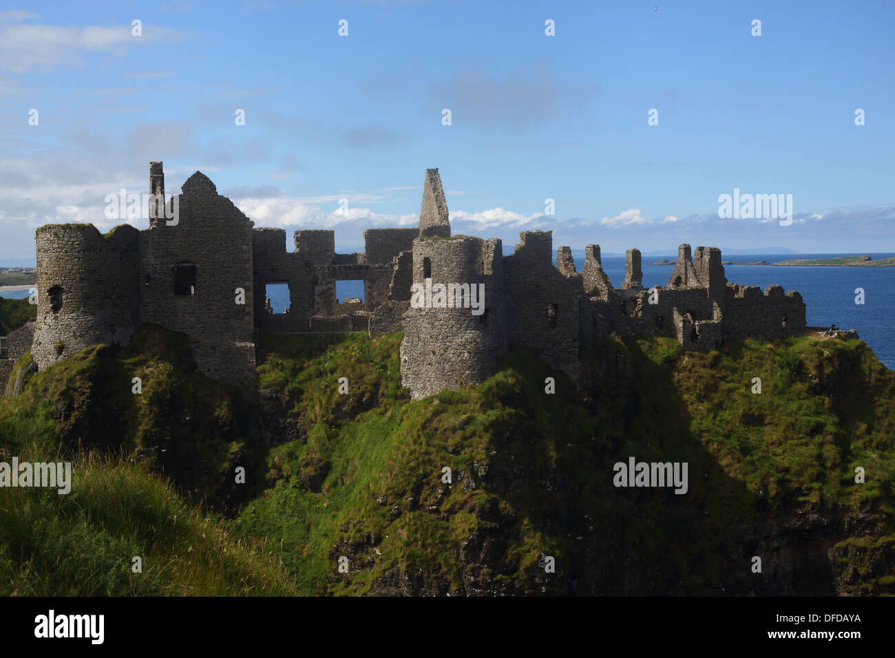 The ruins of Dunluce Castle atop a basalt cliff on the Causeway Coast in Northern Ireland. - Stock Image