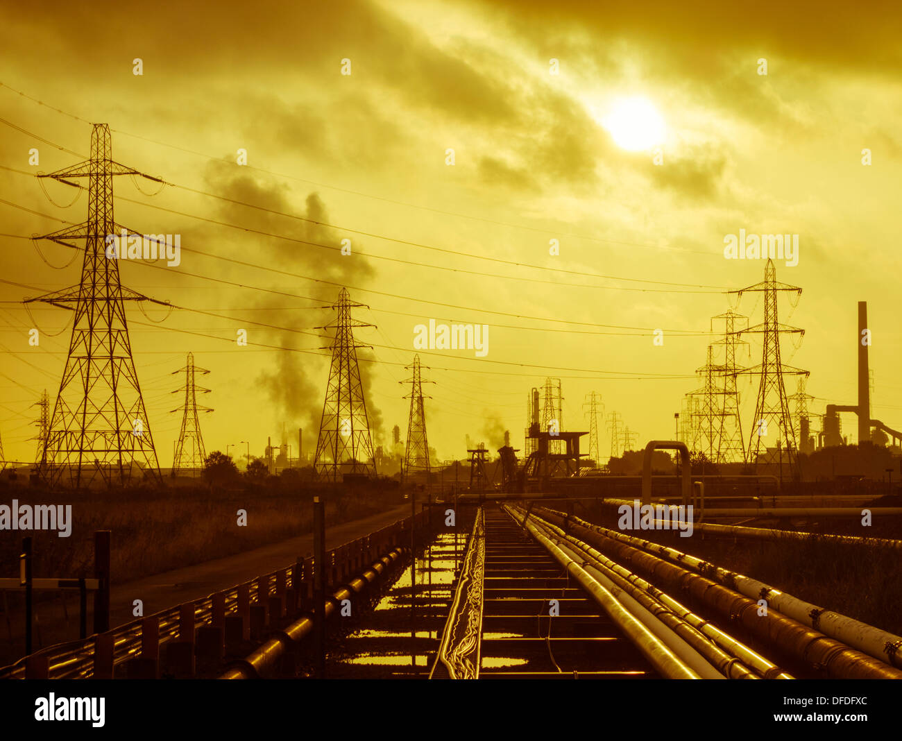 Pipelines and pylons at Seal Sands refineries and petro chemical works between Hartlepool and Middlesbrough, England, UK - Stock Image