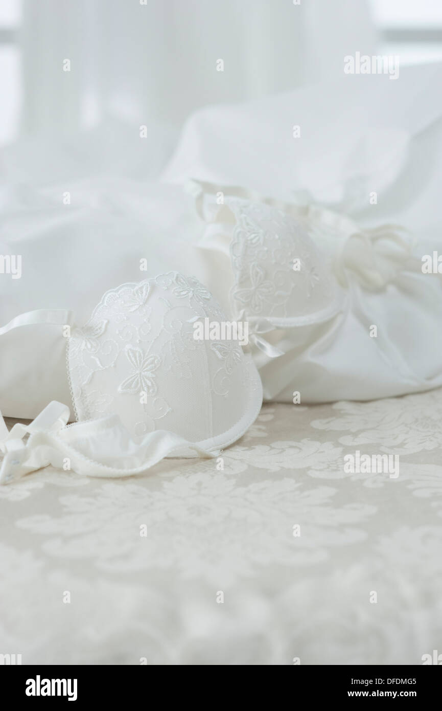 Wedding dress and bra on bed,close up Stock Photo: 61152453 - Alamy