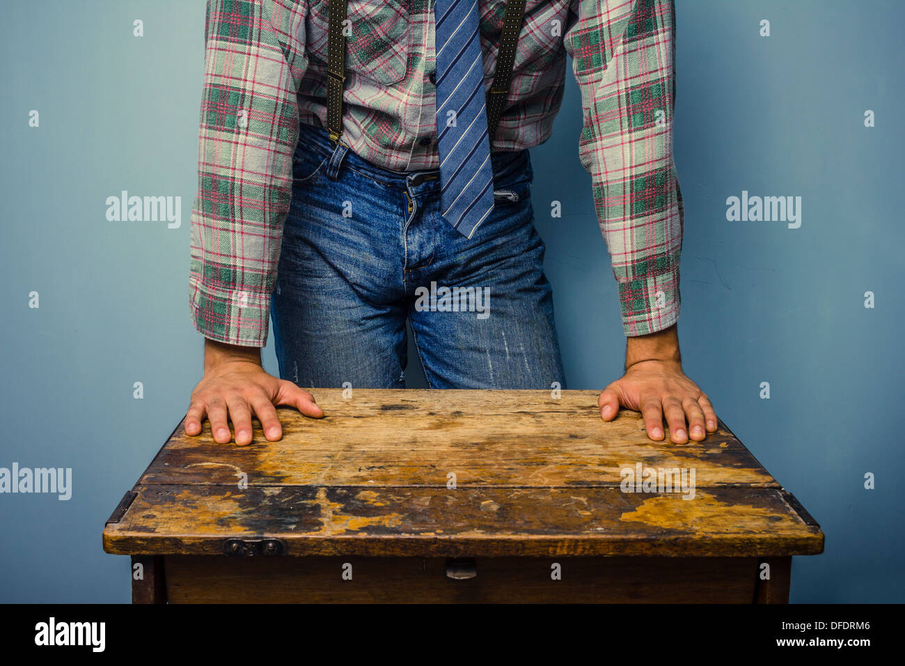 School teacher standing at an old desk - Stock Image