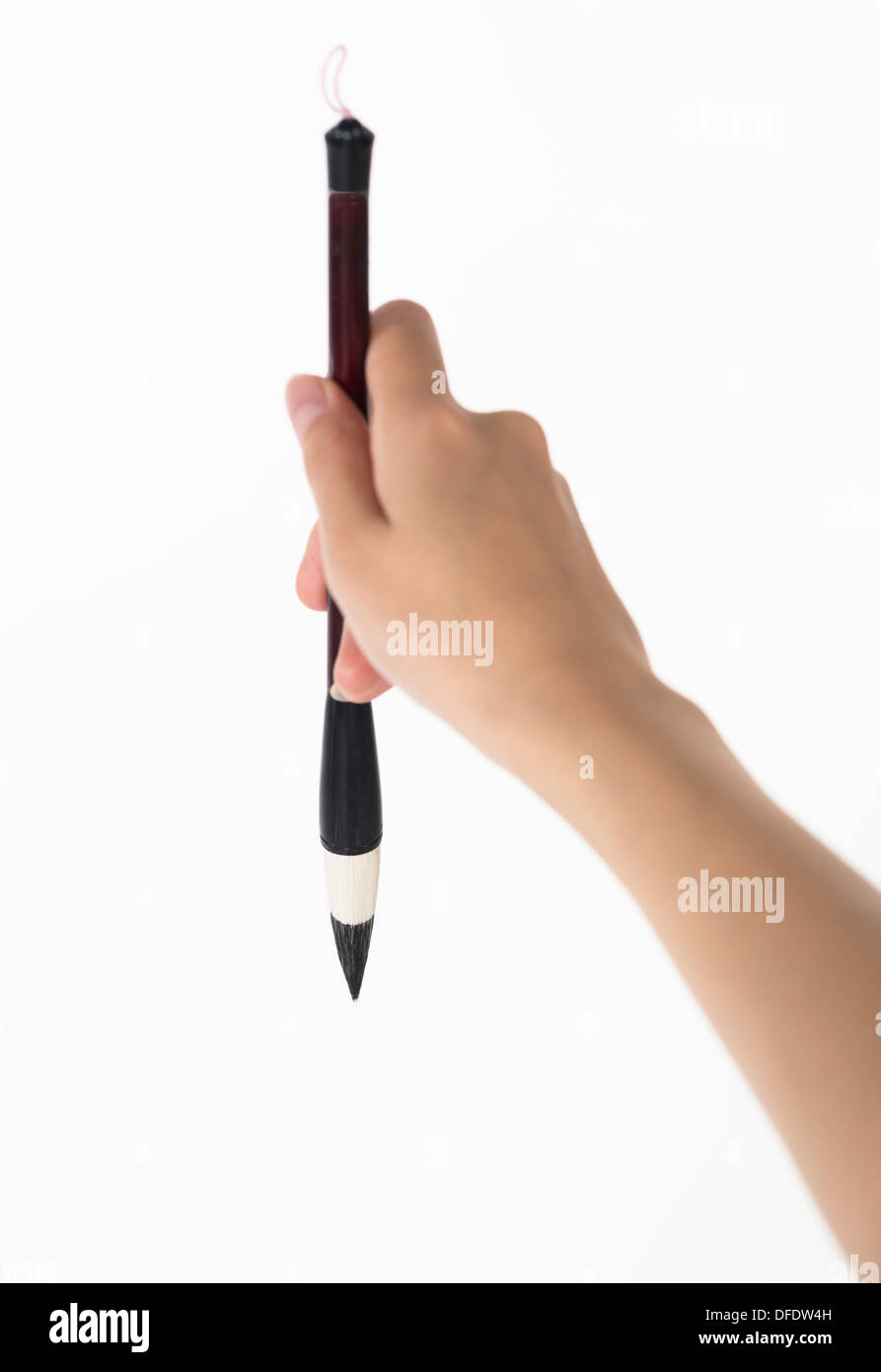writing brush in man's hand - Stock Image