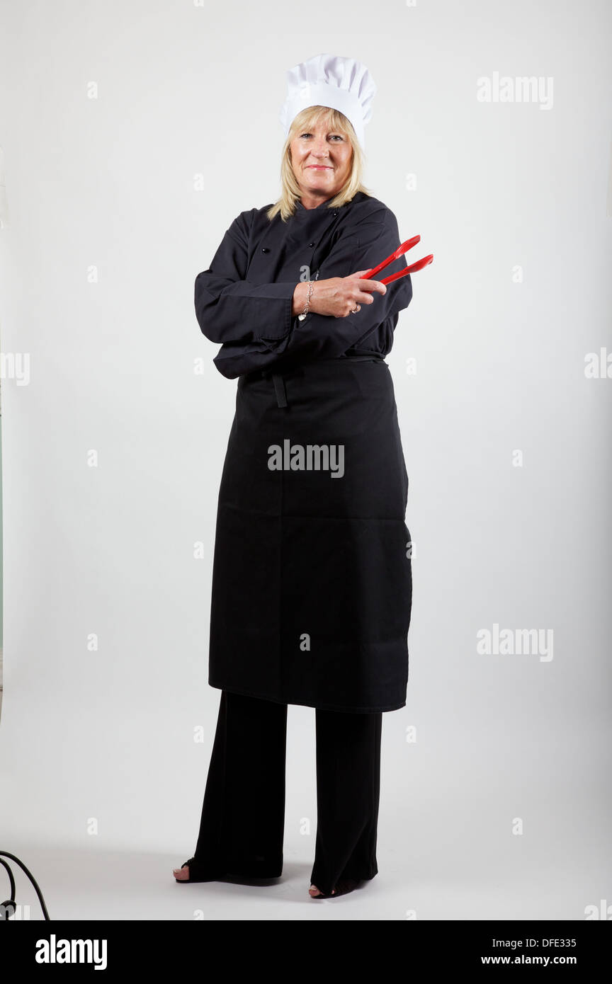 female chef against white background - Stock Image