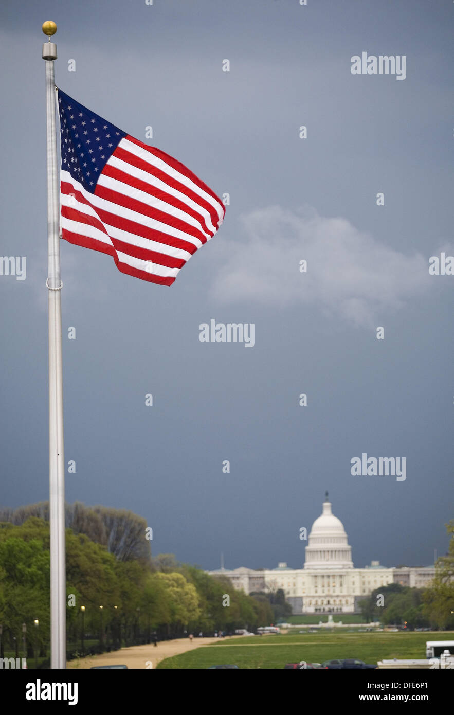 American flag and Capitol Building in background, Washington D.C., USA - Stock Image