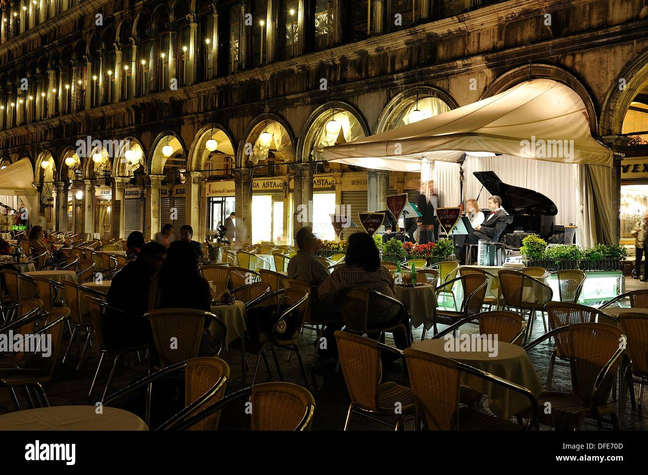 People listening to music at a piano bar (Caffe´ Lavena) in