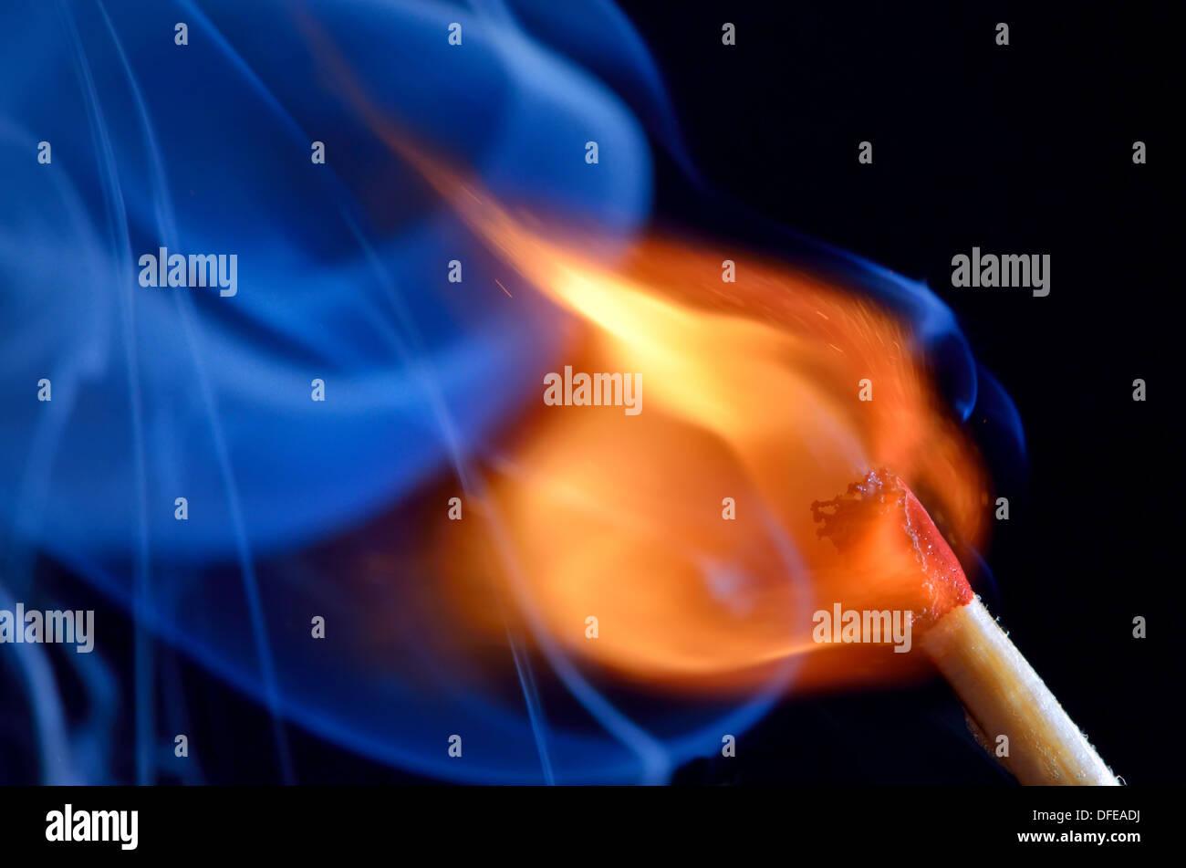 Match bursting to flame - Stock Image