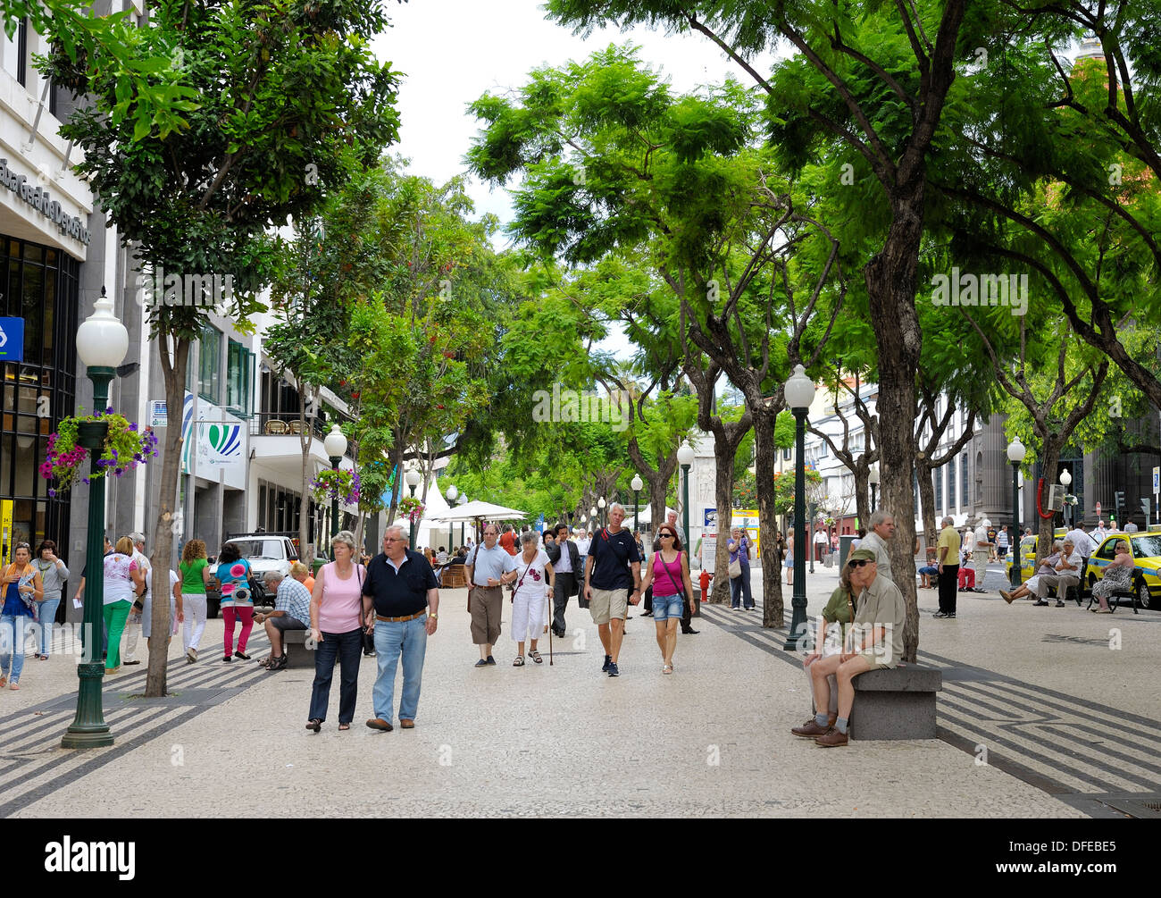 Tourists walking through a pedestrianized area of Funchal Madeira Portugal - Stock Image