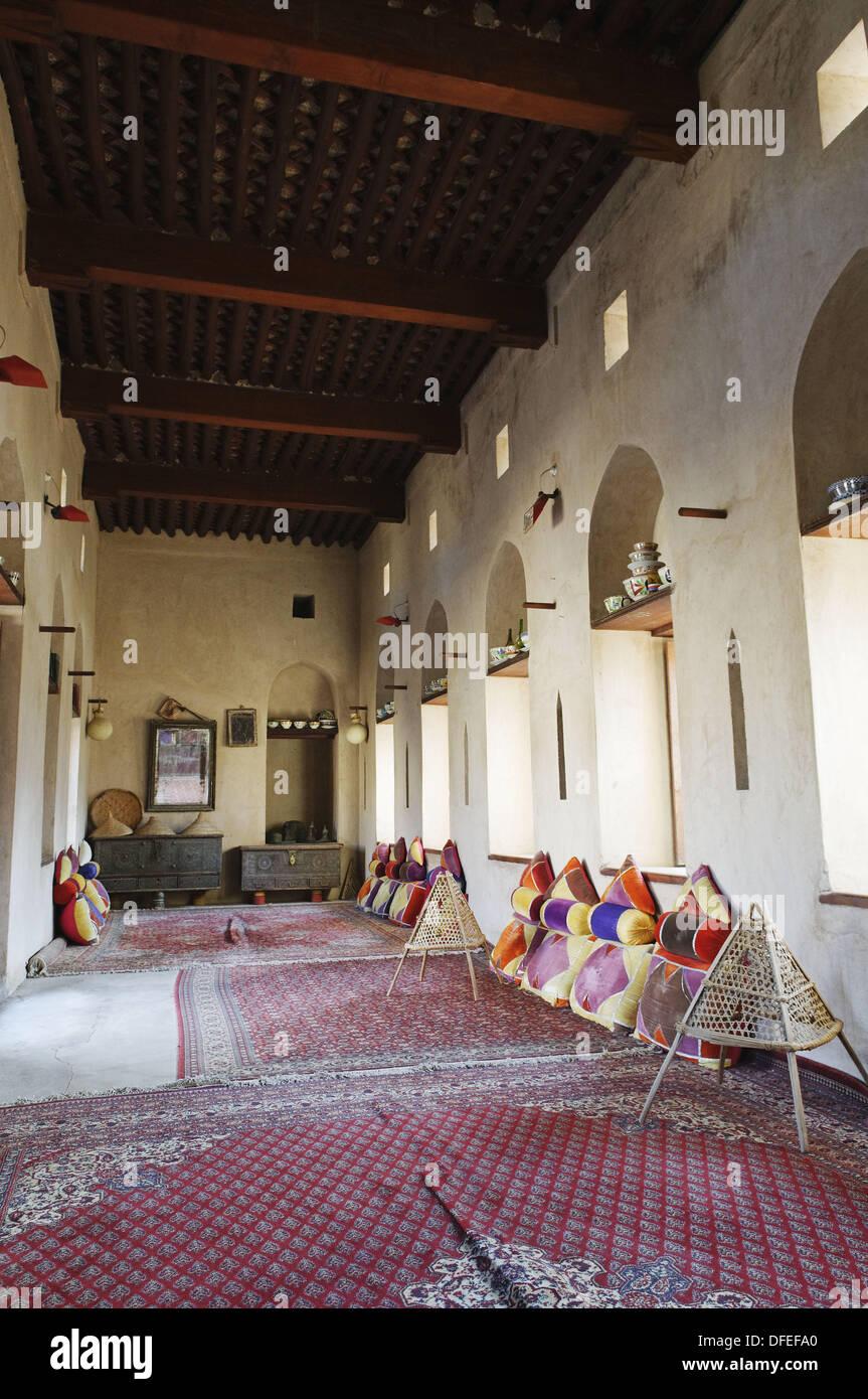 traditional arabian sittingroom, historic adobe fortification Nakhal, Nakhl Fort or Castle, Hajar al Gharbi Mountains, Batinah - Stock Image