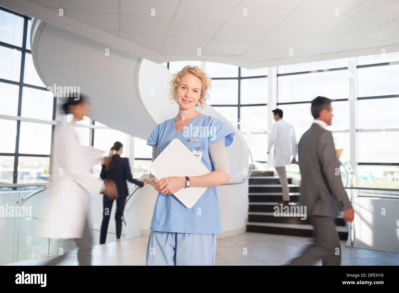 Portrait of smiling nurse in hospital - Stock Image