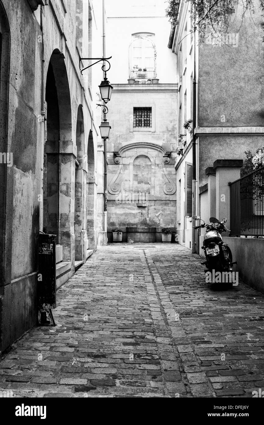 A motorbike parked in a side street at St Pauls Paris, France. - Stock Image