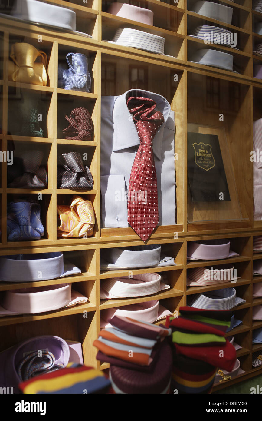 03927903e6b9 Colorful men´s shirts and ties displayed on a wooden rack in a small shop  at Jermyn Street, London, United Kingdom, Europe