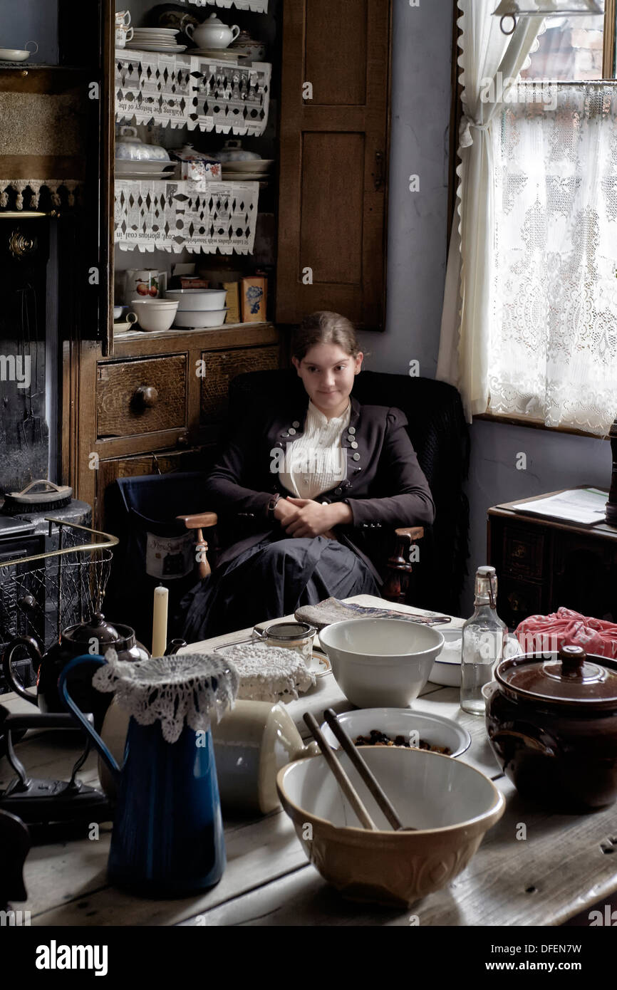 Female employee of The Black Country Living Museum welcoming visitors in a preserved 1800's/early 1900's cottage type home. UK - Stock Image