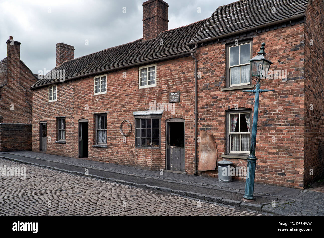 Cobbled street and brick built terraced houses dating back to the early 1900's. Black Country Living Museum Dudley England UK - Stock Image