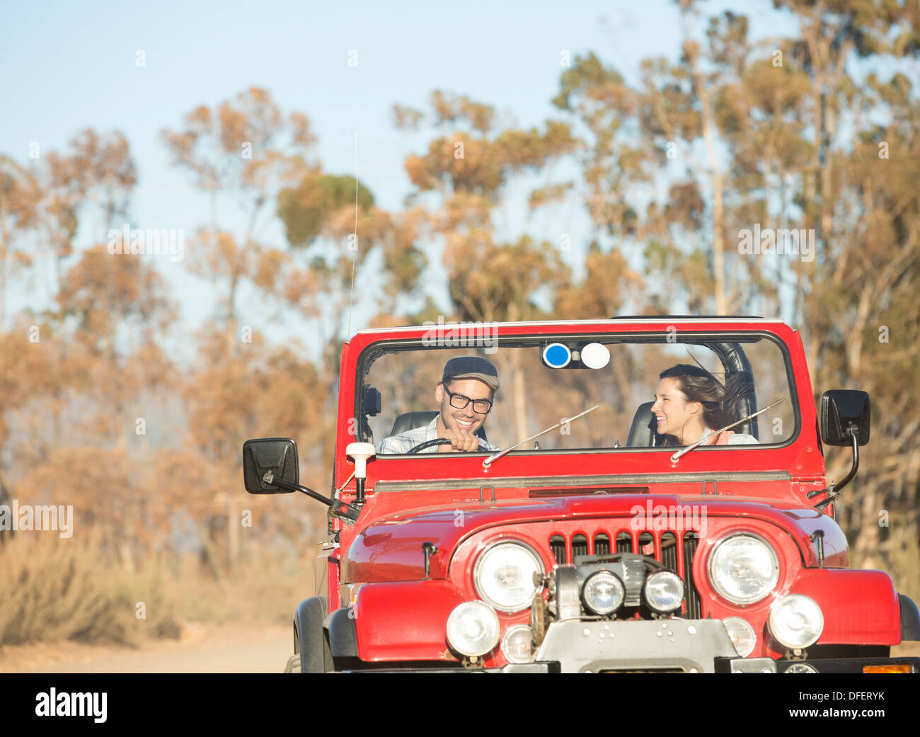 Couple driving sport utility vehicle - Stock Image