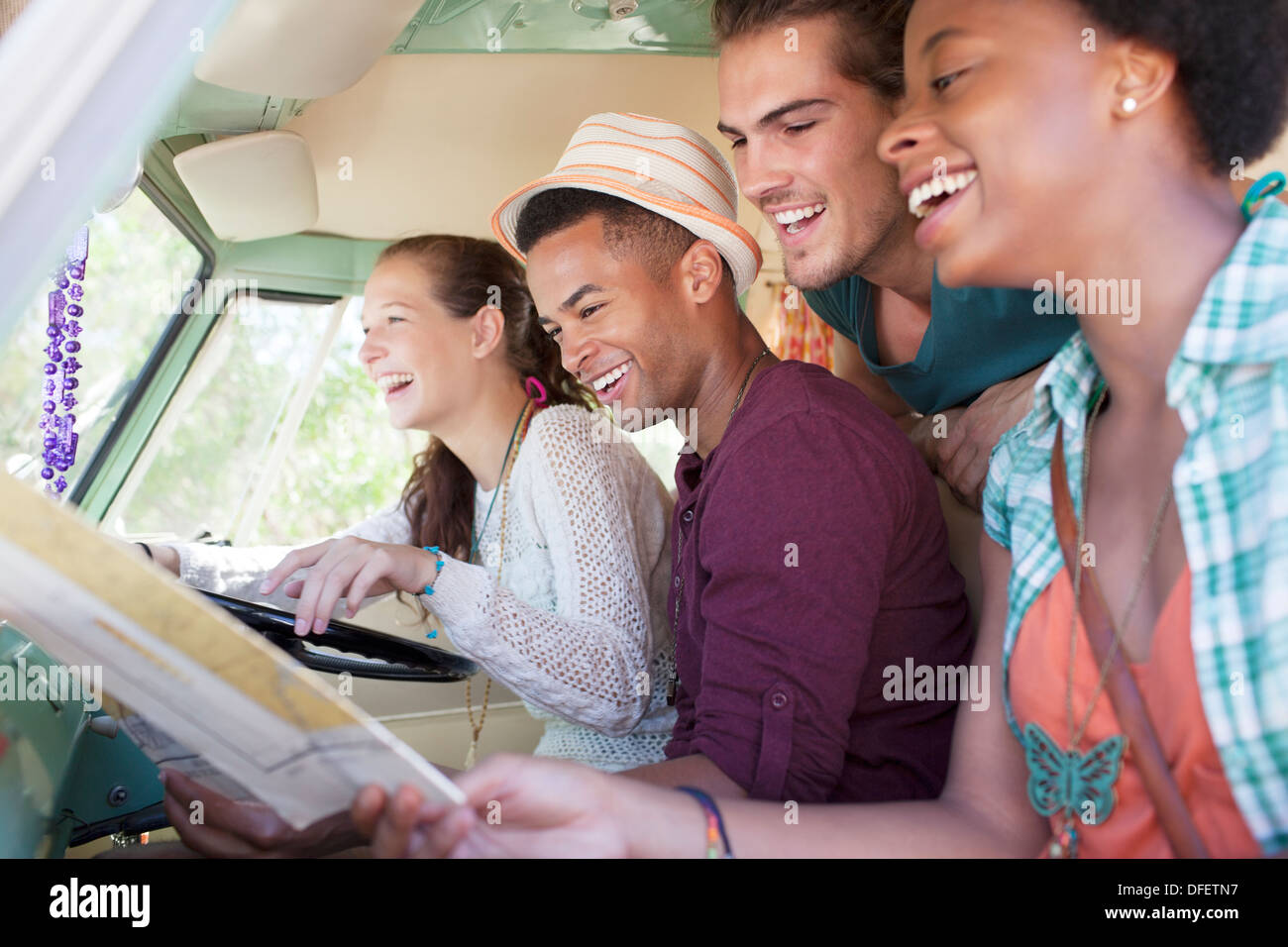 Smiling friends in van - Stock Image