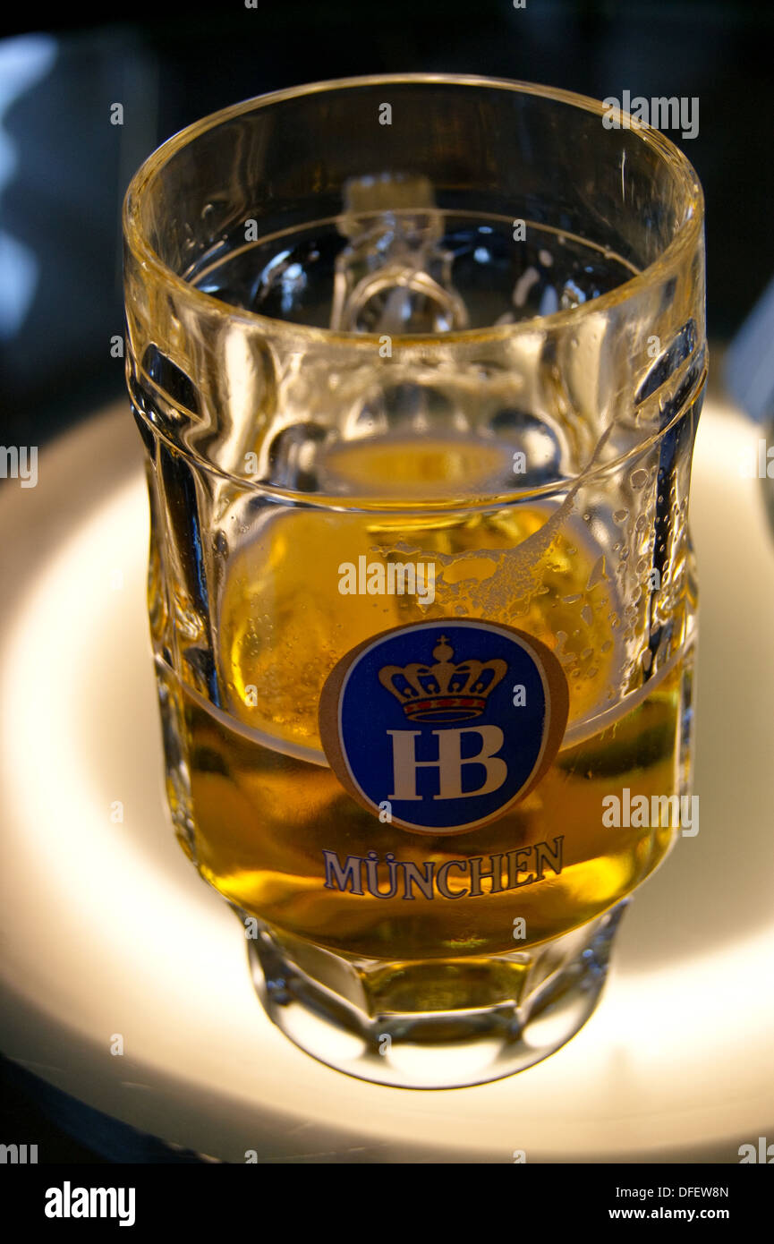 A printed glass of Hofbrau Munchen lager pub table drinks glasses - Stock Image
