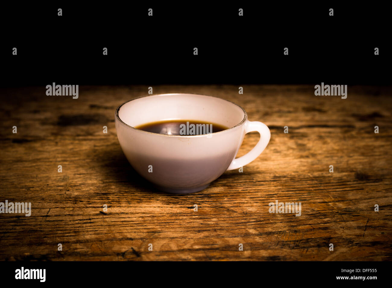 Cup of freshly brewed black coffee on a wood surface - Stock Image