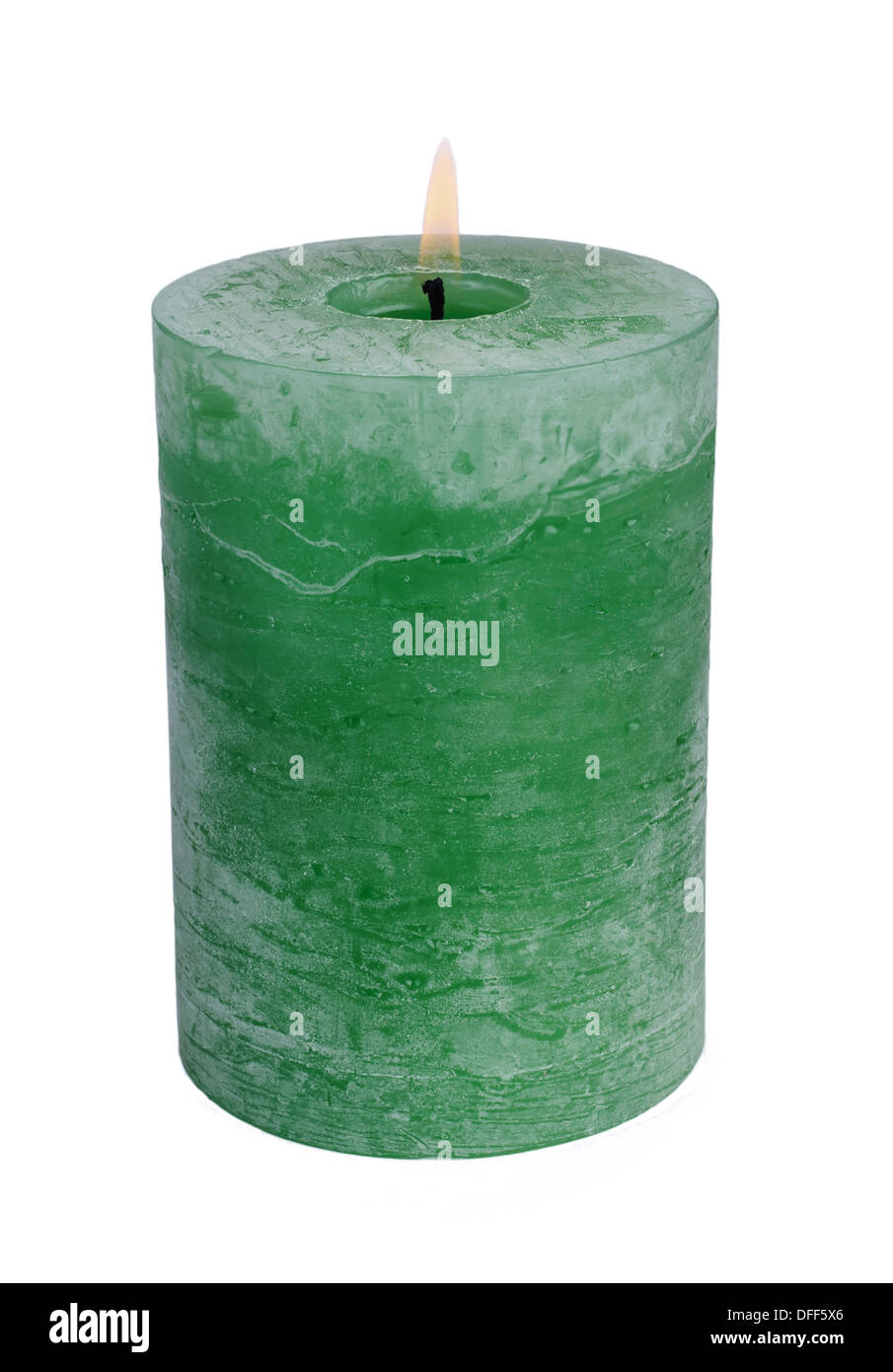 Large green burning candle.Isolated on white. - Stock Image
