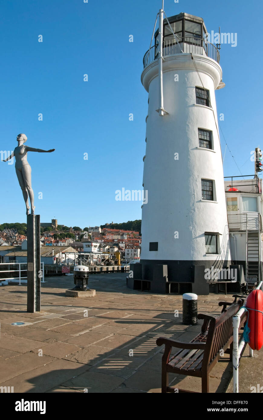 The Diving Belle Sculpture next to the Lighthouse at the harbour of Scarborough, North Yorkshire in England. - Stock Image
